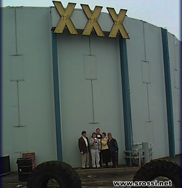 XXX. So, here are 5 teachers standing under the sign for a triple-x book ...