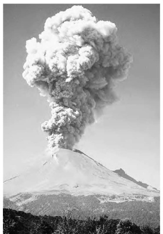 The Popocatepetl volcano erupts, spewing ash, rocks, and gases.