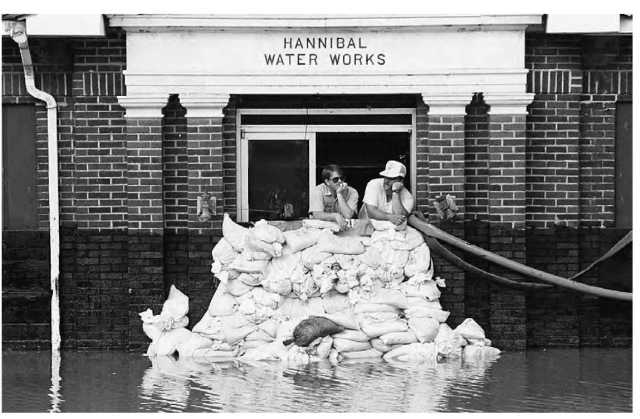 The floodwaters of the Mississippi rise to 4 ft. (1.2 m), surrounding the pumping station in Hannibal, Missouri. Apart from natural causes, floods can result from inconsistent flood management, poor civil engineering design, and unwise agricultural practices.