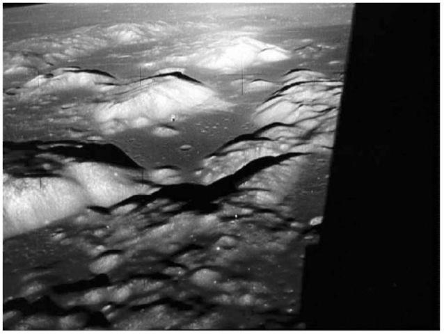 The Valley of Taurus-Littrow as seen from the Commander's window on the left side of the Lunar Module Challenger on the orbit of the Moon before landing. The view is approximately west northwest, looking toward the Serenitatis Basin (courtesy of NASA). This figure is available in full color at http://www.mrw.interscience.wiley.com/esst.