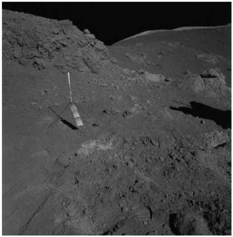 The Station 4 sample locality for the Apollo 17 orange volcanic glass, showing the dark, reddish orange central zone of the deposit and light-colored altered regolith at the left-hand contact (courtesy of NASA). This figure is available in full color at http:// www.mrw.interscience.wiley.com/esst.