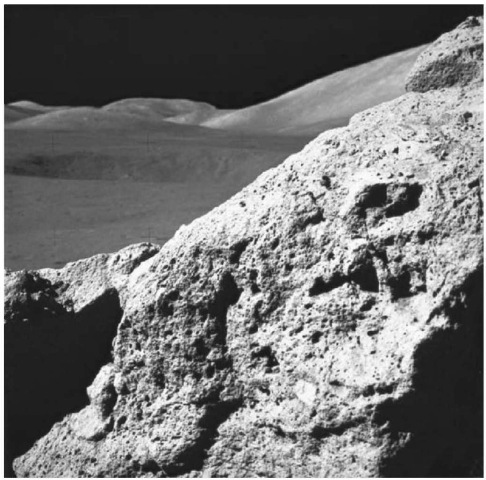 Tan-gray, vesicular impact melt breccia of the boulder at Station 6 shown in Fig. 12 (courtesy of NASA). This figure is available in full color at http://www.mrw. interscience wiley com/esst