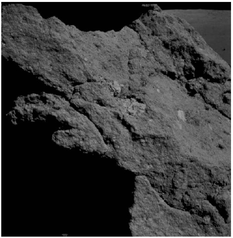 Blue-gray, clast-rich impact breccia of the boulder at Station 6 shown in Fig. 13 (courtesy of NASA). This figure is available in full color at http://www.mrw. interscience.wiley.com/esst.
