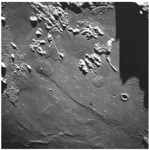 Mare structures near sunrise on the mare basalt surface of the eastern Imbrium Basin (courtesy of NASA). This figure is available in full color at http://www. mrw. interscience.wiley. com/esst.