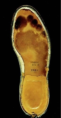 Plate 42 PATTERN EVIDENCE/Bare Footprint Marks Insole of a shoe, showing the darkened and indented sweat areas casued by the weight-bearing areas of a bare foot.