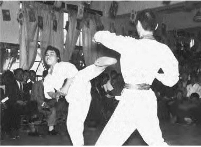Side kick delivered by Miss Kim, ca. 1950.