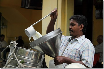 Indian milkman provides home milk delivery services around George Town, Penang