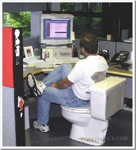 Funny toilet picture | Man at computer using using toilet as chair.