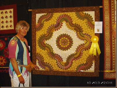 Caryls quilt with ribbon