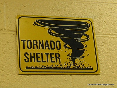 Tornado Shelter sign over the restrooom doors at Camping World