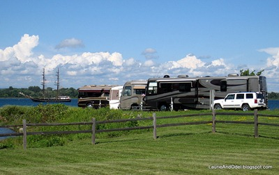 Elks RV parking with tall ship on the river.