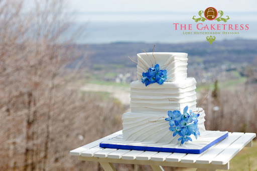 The blue orchids on the cake were handmade and painted out of sugar paste