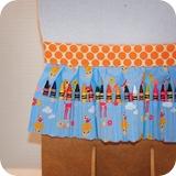 crayon apron toyland orange dots display detail