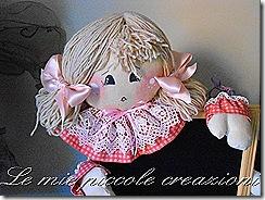 bambola su lavagnetta