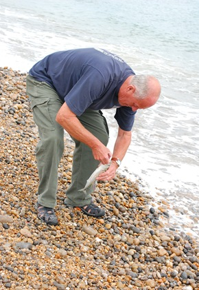 William sea fishing for the first time off Seaton beach. 27/07/2010