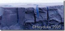 blue ice crevasses in tabular iceberg