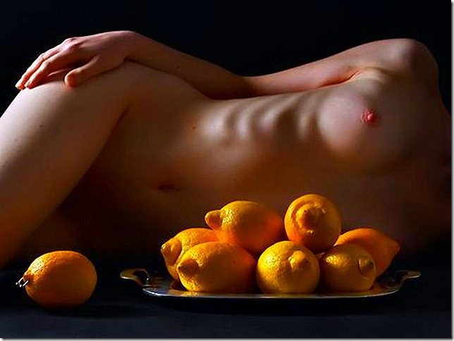 nude woman with lemons