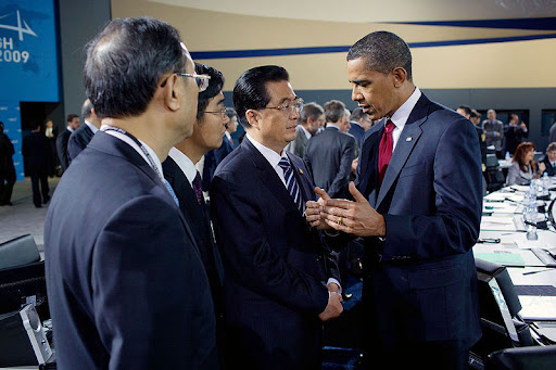 President Barack Obama talks with Chinese President Hu Jintao during the morning plenary session of the G-20 Pittsburgh Summit at the David L. Lawrence Convention Center in Pittsburgh.