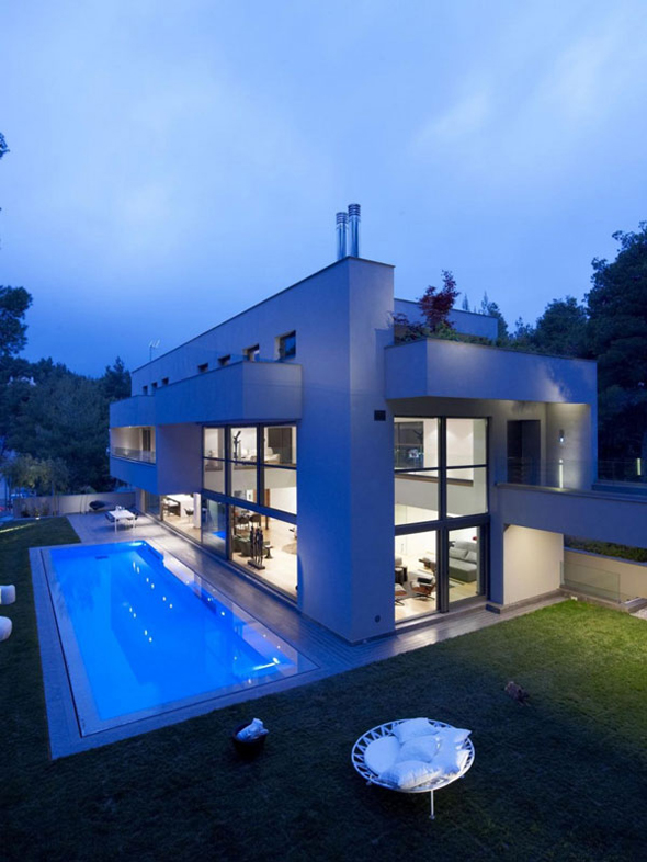 luxury blue home with swimming pool area pictures