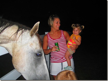 Reagan not too sure about being so close to a horse