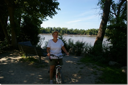Deanna on an inexpensive WalMart bike with the Missouri River in the background