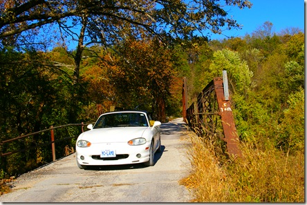 Jim driving his Miata across the old bridge