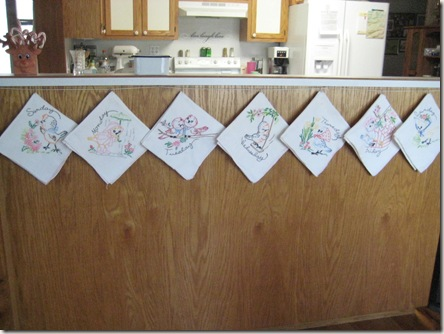 embroidered tea towels hanging up