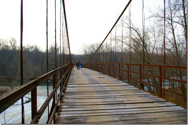 Jim walking across swinging bridge