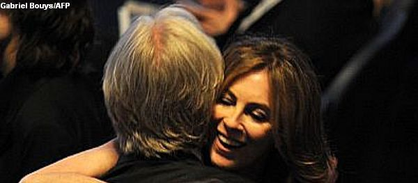 """Nominee for Best Director Kathryn Bigelow  for """"The Hurt Locker"""" hugs ex-husband and nominee for Best Director James Cameron for """"Avatar"""" at the 82nd Academy Awards at the Kodak Theater in Hollywood, California on March 07, 2010. AFP PHOTO / Gabriel BOUYS"""