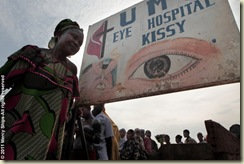 Patients wait outside the Kissy Eye clinic for Mercy Ships screening.