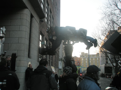 photo shows cameraman lying on camera trolley about 8 foot off the ground