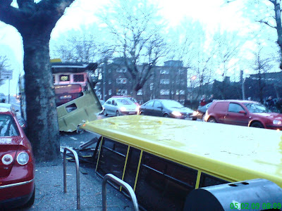 Photo shows the roof of the bus on the road behind it just after the crash. Many of the windows are still intact. Photo taken at 08:09
