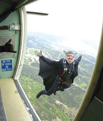 image shows an Irish skydiver dressed somewhat like Dracula who has just jumped out of the plane