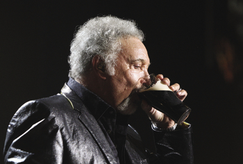 Tom Jones drinks a pint of Guinness at the Arthurs Day celebrations in the Guinness Storehouse
