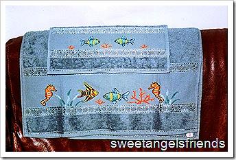 asciugamano pesci