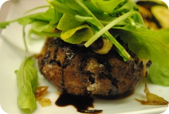 Blue cheese burgers with sauteed onions, balsamic reduction, and arugula