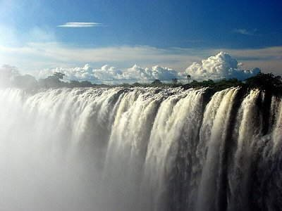 The Devil's Swimming Pool in Zimbabwe, Africa: Victoria Falls has a width of 1.7 km & height of 108m, forming the largest sheet of falling water in the world