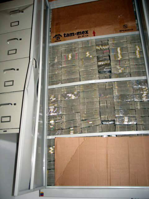 Raid on drug dealer's house in Mexico... lots and lots of cash!
