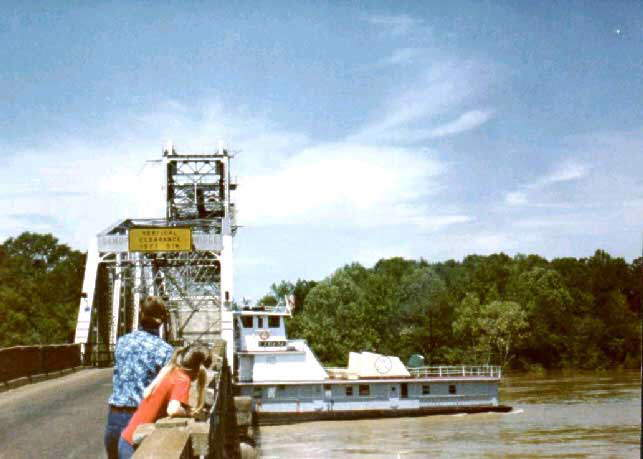 A Towboat hits a bridge, topples over and passes the bridge submerged but gets upright and regains control... just unbelievable!