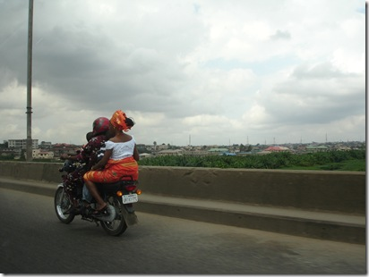 Happy family in traditional outfit in lagos, going home after Sunday mass