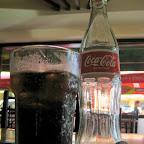 Enjoy a 12 oz. bottle of Coca-Cola at Mamma Maria's Pizzeria
