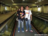 DavaoBase invades Hong Kong! Riding on a walkalator at the HK International Airport.