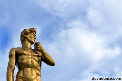 Statue of David set against a blue sky. Located at Baywalk along Times Beach shoreline.