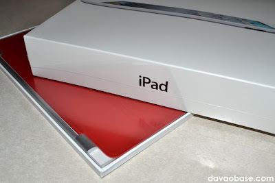 Our iPad 2 in the box, with Produce Red Smart Cover