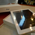 iPad 2 outside the box, with plastic covering