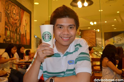 Hubby enjoying a Venti Hot White Chocolate Mocha at Starbucks Coffee in Abreeza Mall