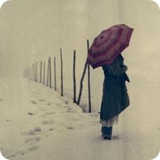 mujer-nieve-paraguas