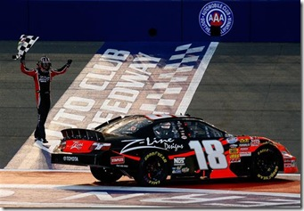 2010 Auto Club Feb NNS Kyle Busch with checkered flag