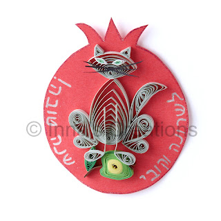 Quilled cat with apple