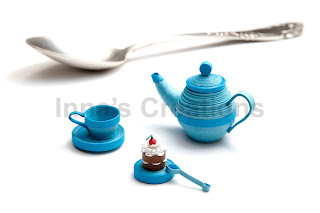 Quilled cup, cake and teapot